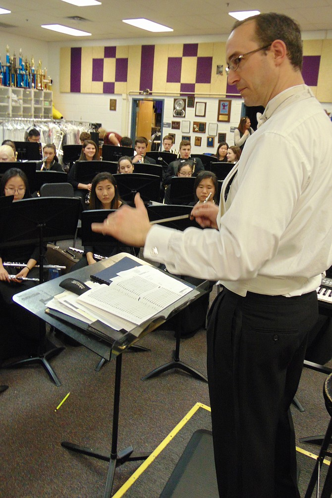 Mike Luley, Lake Braddock Director of Bands, conducts students in the Symphonic Band. The school won the national award, the Sudler Flag of Honor by the John Philip Sousa Foundation.