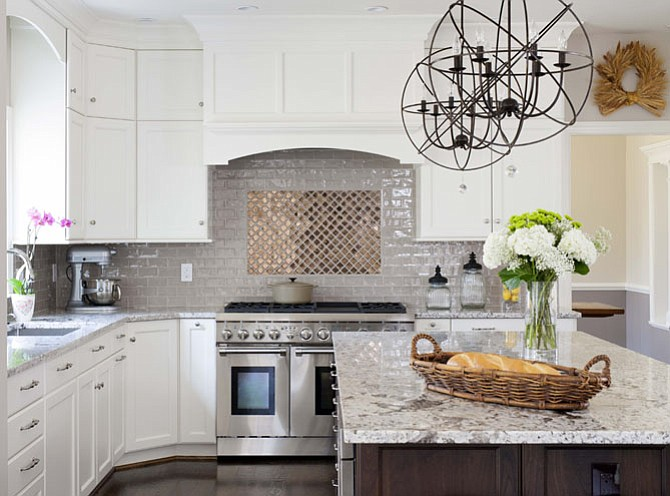 A range that is ornate enough to become the focal point of a kitchen is a must-have feature, according to Michael Winn of Winn Design + Build.