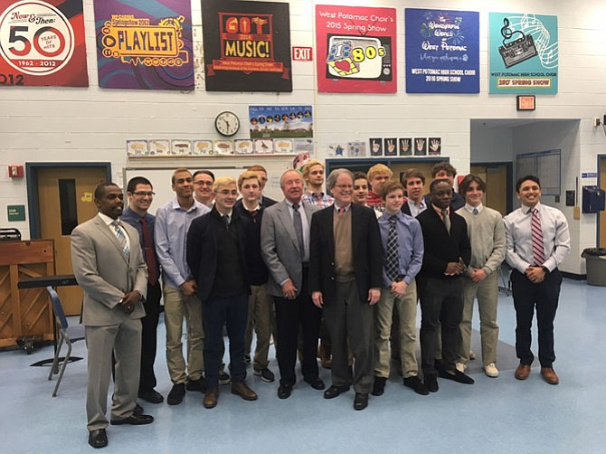 West Potomac High School wrestling coaches, Bruce Huester, Doug Clark, and team.
