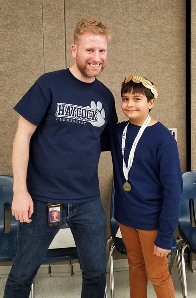 Deven Hagen with Principal Jereme Donnelly.