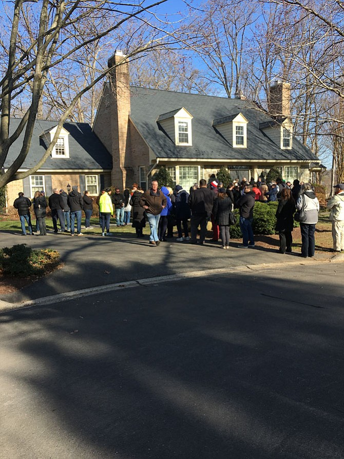 Shoppers and sightseers line up before the opening of the estate sale at the former home of former astronaut and U.S. Sen. John Glenn in Potomac Sunday, March 11.