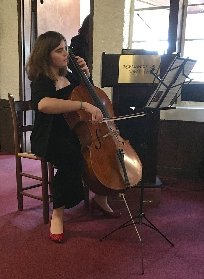 Granddaughter Isabel Srour performs a meditation at memorial service for Farid Srour on Sunday, March 11 at Normandie Farm Restaurant.