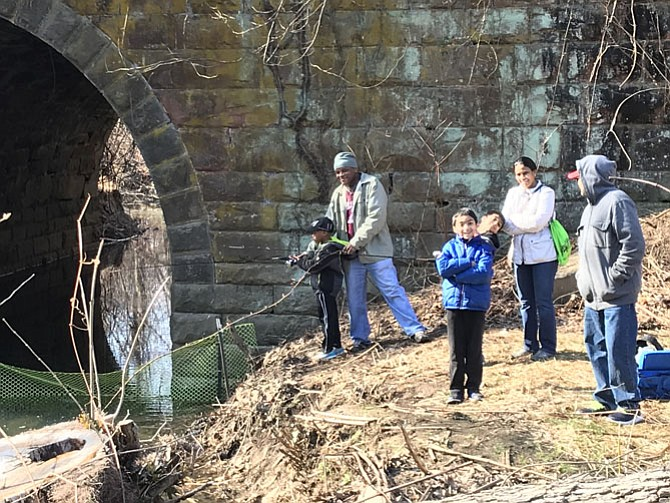 Narendra DaSari and his wife Krishna along with their son Sachin Marshall, 7, and his friend Harshul Chimpalli, cast their lines hoping for the big one at the Herndon Annual Kids Trout Fishing Derby. Andria Sias and his son, Cameron, 6 also try their luck.