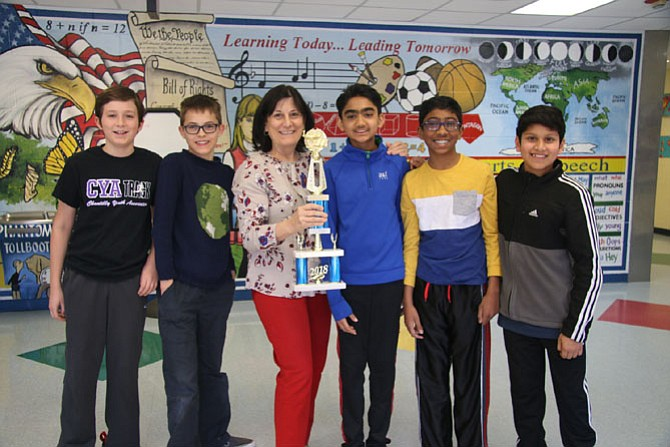 Floris Elementary School finished fourth in the Regional Competition for the 2018 National Science Bowl. Alec Riso, Theo Kiewel, Arnav Mathur, Pranav Panicker, and Mihir Kulshreshtha present the award trophy to Gail Porter, Principal of Floris Elementary School.