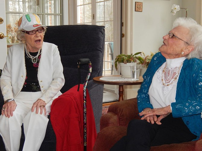 Two centenarians, cousins Mildred DeBell (left) and Iris Vann, sing together.