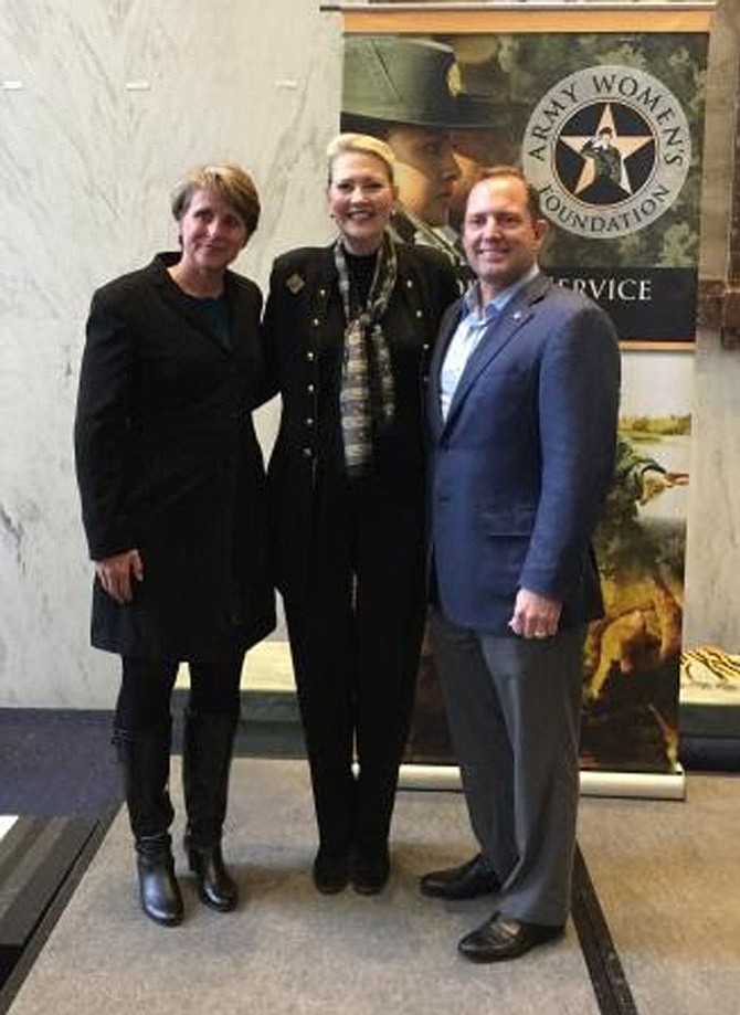 Desert Storm veteran and PenFed employee Michelle Hart (left) and James Schenck (right), PenFed Credit Union President and CEO, flank Brigadier General Anne Macdonald USA (Ret.) and President of the U.S. Army Women's Foundation.