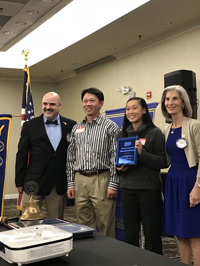 The Rotary Club of Herndon honored Tiffany Nguyen and her father Timothy as Outstanding Volunteers at the 52nd Annual Herndon Rotary Club Citizen of the Year and School Volunteer Recognition Banquet.  With them are Kurt Rose, Emcee/Member Herndon Rotary Club and Dee Casio, President Herndon Rotary Club.