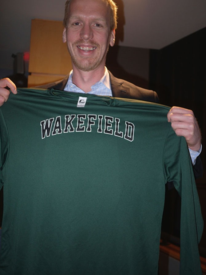 Eric Berkenpas enjoys making cameras that can get inside a forest fire, down to the deepest part of the ocean, and attached to deep sea creatures. He was given a Wakefield T-shirt by the students who heard him speak.