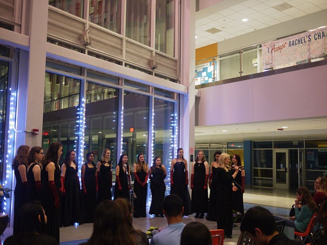 Something Extra performs in the atrium of Yorktown High School, providing a Q and A session with Yorktown's Chamber Choir afterwards. Yorktown's long-term substitute for the choir program, Kyra Klontz, is in the foreground.