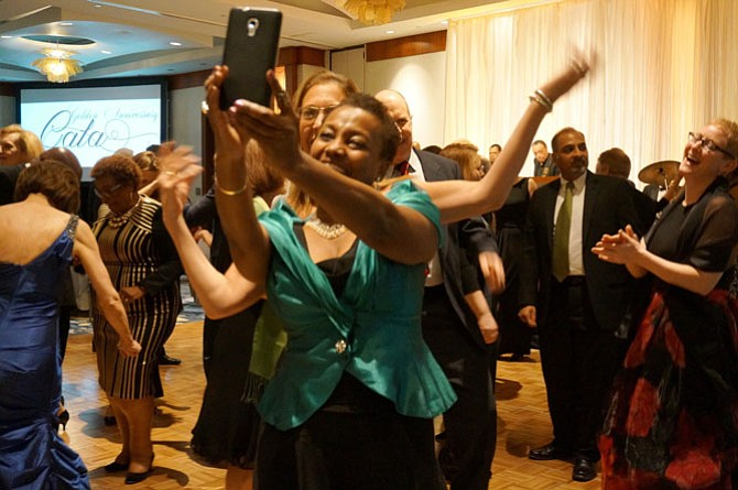 Amanda Chandler poses for a selfie with a friend as they dance to the music of Bruthers Plus One.