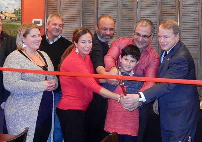 Cutting the restaurant's ribbon are (from left) Fairfax City Councilwoman Jennifer Passey, the Economic Development Authority's Craig Havenner, Angela Ribulotta, Chef Elvis Amor, Dante Ribulotta, Angela's son Lorenzo, 9, and Mayor David Meyer.