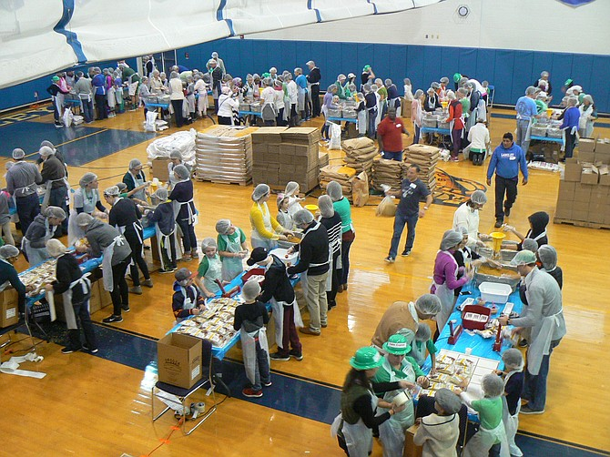 The Langley School community came together for the school's first-ever Day of Giving on Saturday, March 17 to pack 75,000 meals for the people of Puerto Rico.