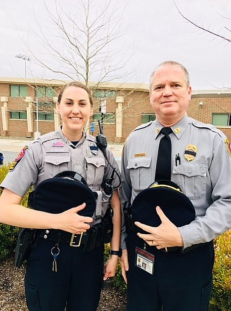 Officer Ashley Block with Capt. John Trace. Block, a McLean District Station police officer, was severely injured while helping clear a road during the March 2 wind storm.