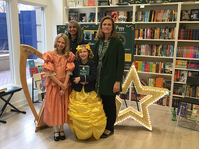 "From left: Lever Harpist, Nyx Hauth; Addison Duncan (dressed as Angelica Schuyler); Megan Duncan (dressed as Peggy Schuyler) and author L.M. Elliott celebrated St. Patrick's Day and the launch of the Elliott's new book, ""Hamilton and Peggy! A Revolutionary Friendship"" with classical Irish harp music, as well as performances from the musical, ""Hamilton""."