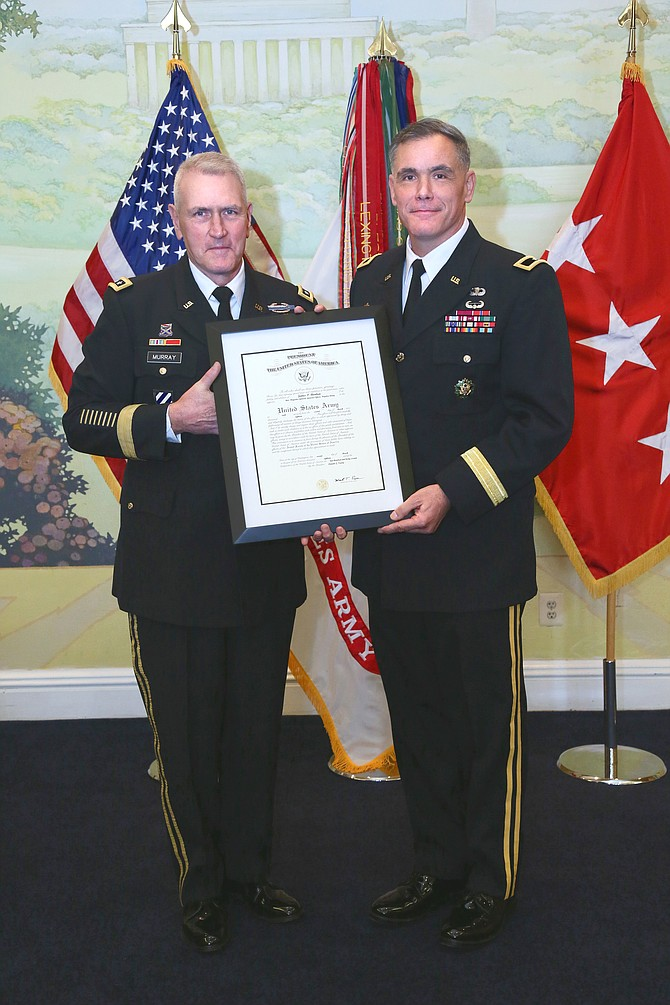 New U.S. Army Brigadier General James P. Bienlien (right) receives his promotion order from U.S. Army Lieutenant General Mike Murray on March 23 at Patton Hall in Ft. Meyer, Va.