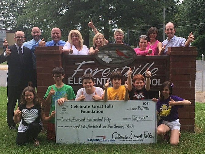Students and representatives from the Forestville, Colvin Run and Great Falls elementary schools and the Celebrate Great Falls Foundation gather at Forestville Elementary on June 15, 2015 for the tournament and online auction check presentation.