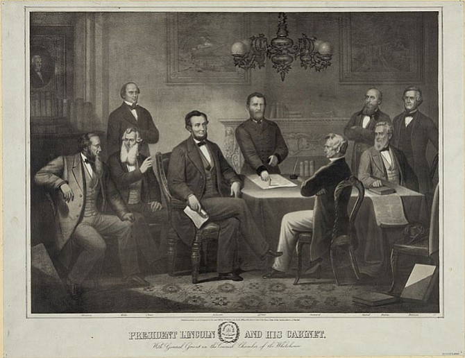 President Abraham Lincoln and his cabinet at the White House discussing the draft Emancipation Proclamation.