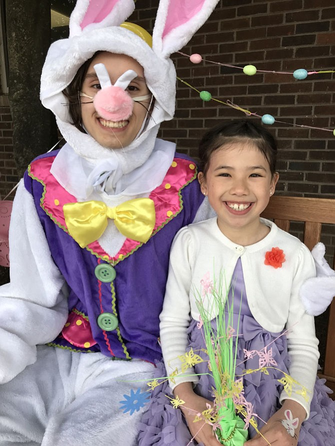Amber Yin was more than happy to sit beside the ubiquitous Easter Bunny after Easter Services Sunday morning at Restoration Church, the Reston campus of Floris United Methodist Church. Worship services are held each Sunday at 10 a.m.