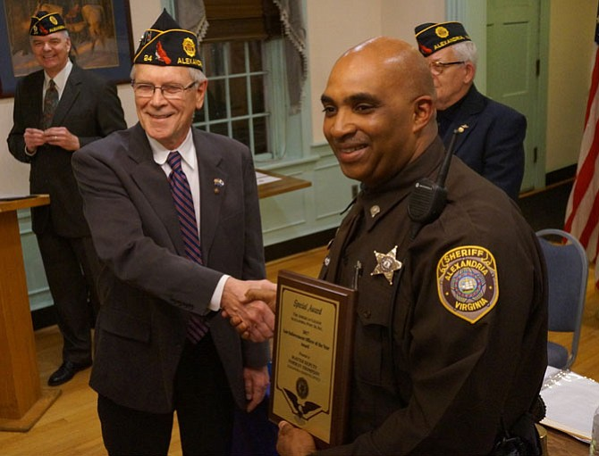 Master Deputy Norman Thompson, right, is congratulated on the Law Enforcement Officer of the Year Award by American Legion Post 24 Commander Doug Gurka.