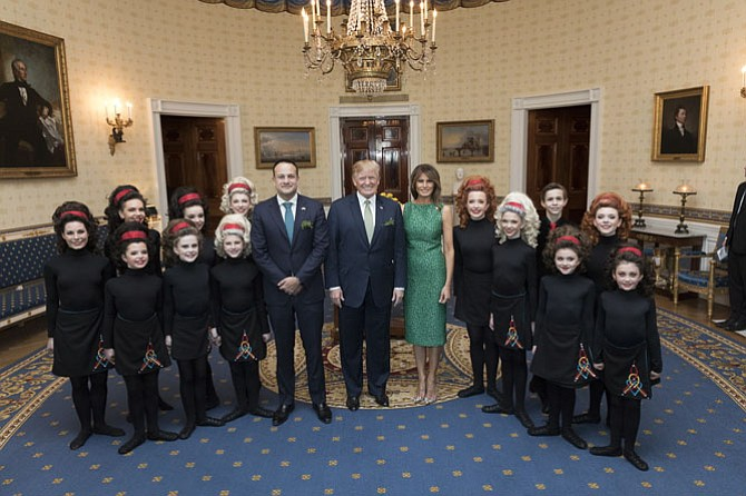 President Donald J. Trump, First Lady Melania Trump and Irish Prime Minister Leo Varadkar pose for photos with dancers from the McGrath Academy of Irish Dance in the Blue Room at the White House, Thursday, March 15, 2018, in Washington, D.C. Vice President Mike Pence and Mrs. Karen Pence attend.
