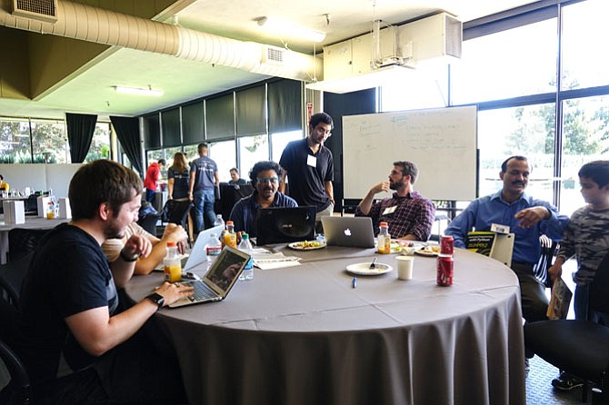 People work in teams and build out their data ideas in a Sunnyvale, Calif. hackathon in 2016.