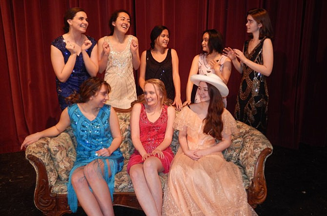 Rehearsing a scene are (standing, from left) Emily Draut, Annie Silva, Elise McCue, Valerie Mellard and Molly Marsh, and (seated, from left) Caroline Woodson, Lauren Spiers and Kylee Downie.
