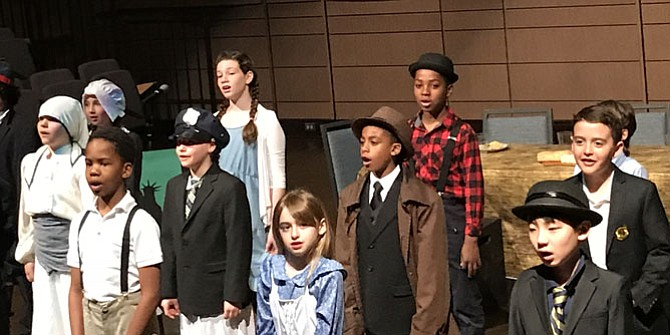 "Fourth grade students perform an original play about immigration called ""Journey to Freedom."""