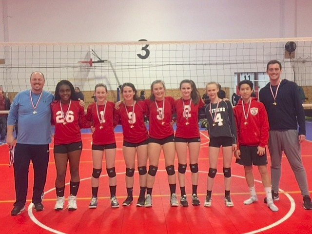 The Alexandria Titans' 14 Black team of the Alexandria Titans Volleyball Club took home the Gold Medal at the March 10, Maryland Juniors Sportsplex Tournament in Jessup, Md.  Coaches and players of Titans 14 Black include (from left) Derek Baxter (head coach),  Nia Baskin, Maura Munson, Lauren Thiell, Kaitlin Peters, Natalie Keough, Anna Harrington, Dylan Rex and Jeff Klein (assistant coach). Missing from the photo include Tess Lundgren, Nellie Hartell, and Addie Fielding.