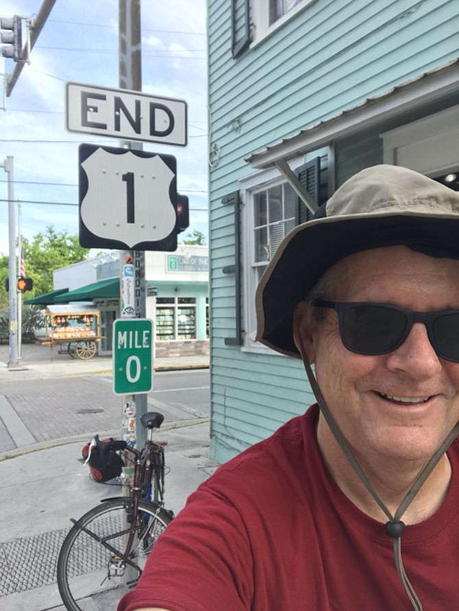 John Pickett at Mile 0 in Key West. Note the floppy hat he brought for the sun. It came in handy when the wind was blowing wet sand into his left eye coming down the Florida coast.