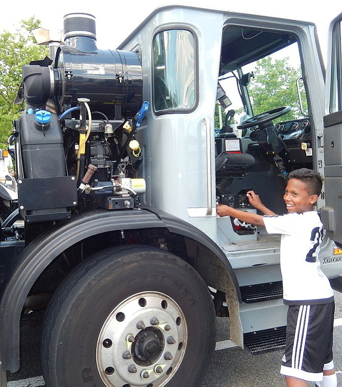Operating the sidearm loader of this Fairfax County trash truck at a 2016 Touch-A-Truck event in Chantilly is Arnold Reyes, then 10. Touch-A-Truck will be part of Springfest.