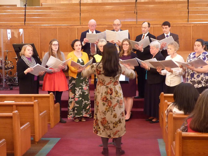 The choir from the Church of Jesus Christ of Latter-day Saints, Mount Vernon, with its director, Mary Nelson.