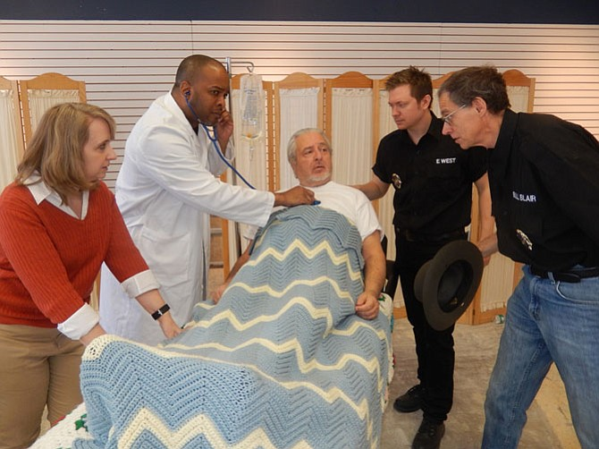 Rehearsing a hospital scene are (from left) Sharon Caraballo (as Etta West), Mick Butler (Dr. Ash McKay), Joe Russell (Ira West), DJ Neace (Eliot West) and Geoff Baskir (Sheriff Bull Blair).