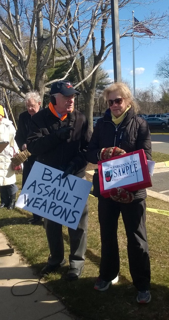 "Del. Kenneth R. Plum (D-36) of Reston, left, congratulates Falls Church activist Carol P. Luten, right, of the Coalition to Stop Gun Violence for her push to get the only gun control measure passed March 9 through this year's Virginia General Assembly, House Bill 287, a special state license plate that says ""Stop Gun Violence."""