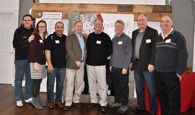 SYA Board of Directors, from left: Rob Lymburner, Rugby Commissioner; Susan Malkus, Field Hockey Commissioner; Damien LaRuffa, Lacrosse Commissioner; Jeff Stein, Vice President; Gary Flather, President; Bob Woodruff, Little League Commissioner; Dave Scanlon, Basketball Commissioner; and Brian Seeley, Babe Ruth Commissioner. (Not pictured: Pete Cuomo, Secretary; Bryan Hunt, Treasurer; Tammy McCarron, Cheerleading Commissioner; Ted Diacoumis, Football Commissioner; Erich Wiemann, Soccer Commissioner; Shashana Courtney, Softball Commissioner; Alonzo Davis, Track & Field Commissioner; Pat Alexander, Volleyball Commissioner and Ken Brown, Wrestling Commissioner.