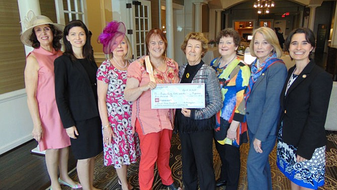 Members of the Oakton Women's Club presented a $5,000 check to the Fairfax County Public Schools' Food and Nutrition Services' Breakfast After the Bell Program.