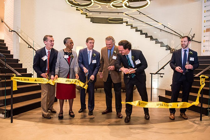 Official Ribbon-Cutting at the Aperture Grand Opening Celebration. From left: Casey Veatch, Veatch Commercial Real Estate; Supervisor Cathy Hudgins (D-Hunter Mill); Chuck Veatch, The Charles A. Veatch Co., joint venture developer of Aperture; Tom Bozzuto, Chairman, The Bozzuto Group; Toby Bozzuto, President and Chief Executive Officer, The Bozzuto Group; Mike Henehan, Senior Vice President, Managing Director for Bozzuto Development Company. Aperture Apartments, a six-story, 421-unit luxury building in Reston is across from the Wiehle-Reston East Metro station.