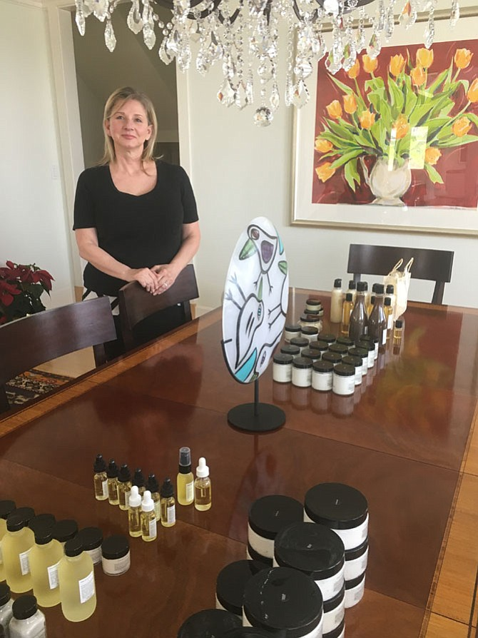 Potomac resident Renan Kennedy, creator of Sans Skincare natural products, shows some of her products at her home on Thursday, April 12. She started a line of natural skincare products after searching for soothing moisturizers for her mother, who was undergoing chemotherapy.