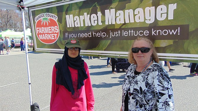 Burke Farmers Market Managers Hala Elbarmil and Lisa Kershes.