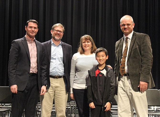 The 2018 Fairfax County Spelling Bee awarded first place to Eric Kim of Wakefield Forest Elementary School in Fairfax.  Pictured from left: Joni Pepin (Judge), Matthew Shinkman (Judge), Sarah Lundquist (Judge), Bee winner Eric Kim, Blake Giddens (Pronouncer).