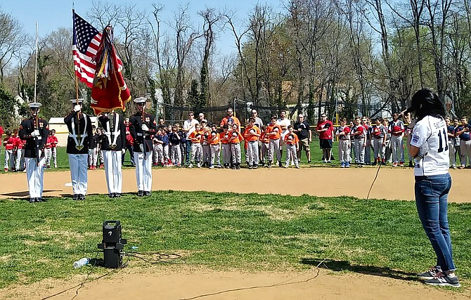 The Marine Corps Color Guard joined the Alexandria Potomac Little League from the Marine Barracks, Washington D.C. on Saturday, April 14. The parent singing the National Anthem is Karen Moreno Sayles.
