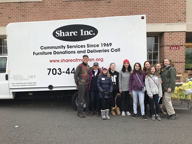 NDWC members and their families joined with Girl Scouts from Troop 6043 volunteered to stuff SHARE truck at Giant. From left: Richard, Jennifer, and Libby Salopek; Kaylee Marinus; Faisa and Praha Stafford, Jana and Keira Allen; Alex and Jennifer Wood.