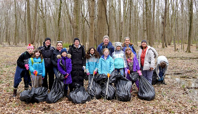 Girl Scout Junior Troop 3446 from Springfield were joined by their parents to help clean up Huntley Meadows Park in Alexandria.