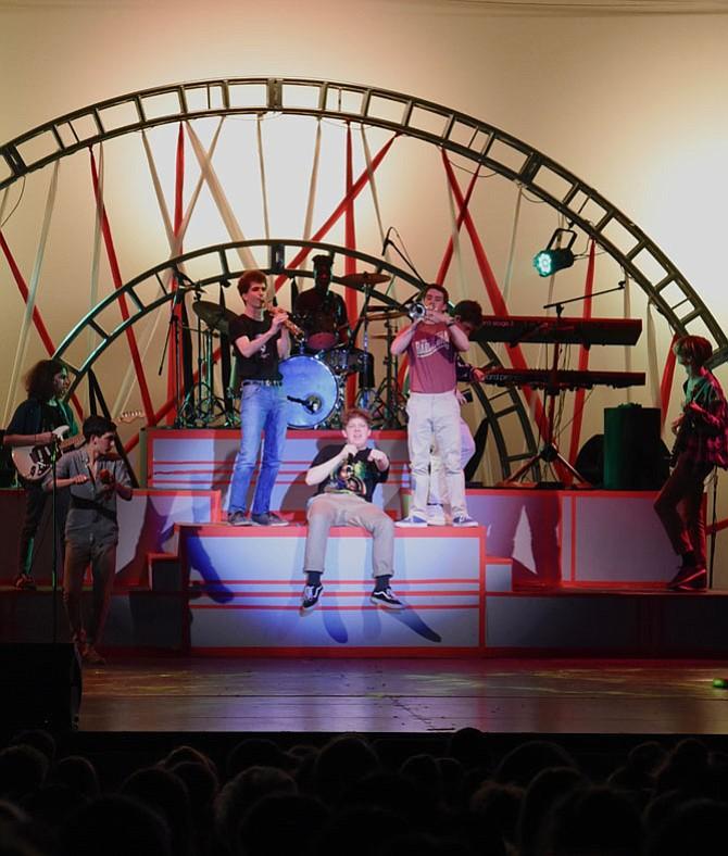 From left are Adam Isaacs, Ethan Askarinam, Ethan Dodd, Siya Dalton, Ethan Hughes (singing), Patrick Wright, Luke Walker (behind Patrick), and Chris Brown.