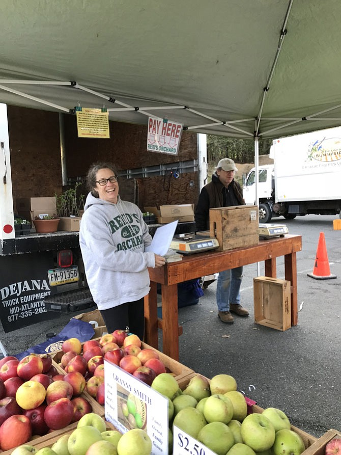 Vendors at Reid's Orchard are nearly ready for the first day of the Reston Farmers Market.