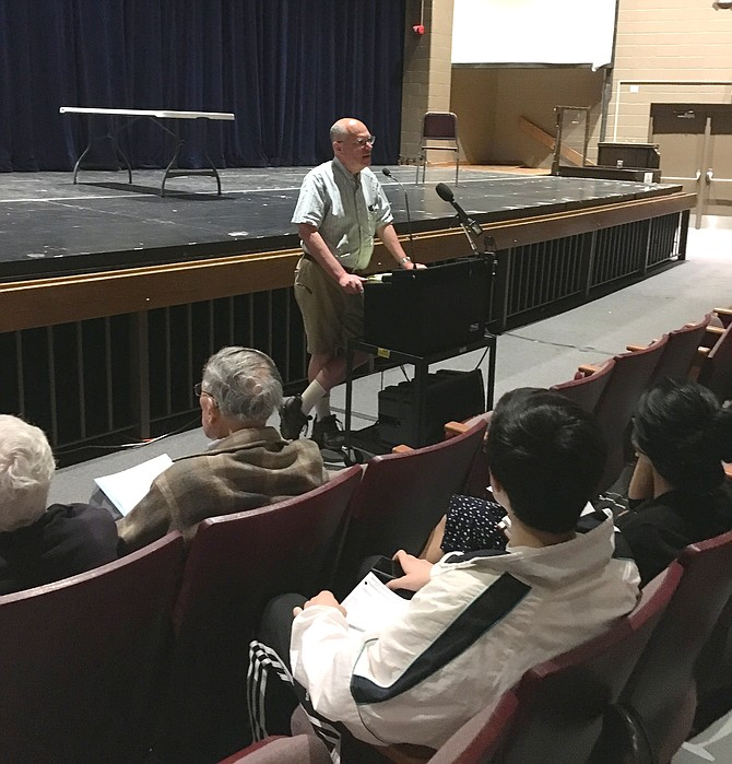 Richard Boltuck begins a meeting to discuss Maryland State Highway Administration changes to River Road at Walt Whitman High School Monday night. The changes focus on safety improvements at the intersection of Braeburn Parkway and River Road and the pedestrian crosswalk east of that intersection.