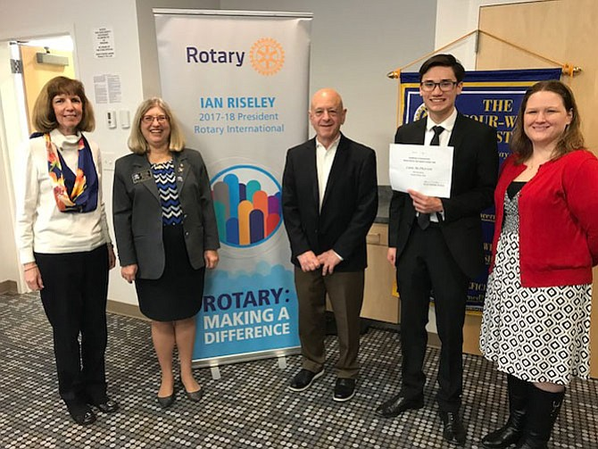 Fairfax High School Junior Liam McPherson won the Rotary District 7610 Speech Contest. Pictured from left are: Paula Brown Kelley, Past President of Fairfax Rotary, Rotary 7610 District Governor Ronnie Chantker, Barry Gordon, Fairfax Rotarian and Speech Contest representative, Liam McPherson, Speech Contest winner, Heather Davids, FHS Forensics (Speech) Coach.