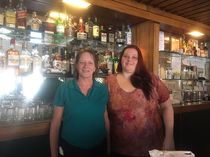 Behind the bar, Michelle Riggleman, right, and wait staff Kat McGowan are working to preserve the home-style restaurant.