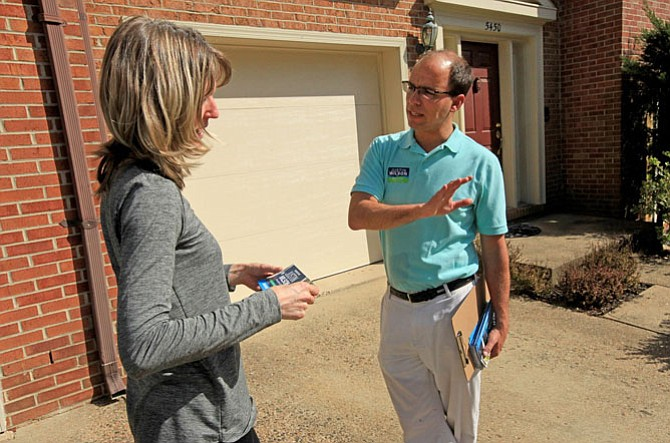 Vice Mayor Justin Wilson talks with Myla Sisk, April 14.