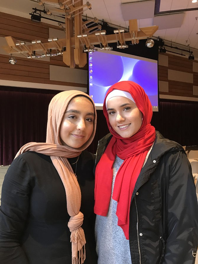 From left, Nura Behgoman, 16, of Afghanistan and a student at Herndon High School, and Danya Abdel-Latif, 18, of Palestine and a student at Park View High School, attended the event to honor Nabra Hassanen's life and support her family as the anniversary of her tragic killing nears. 'You never expect it to happen to someone in your community,' said Behgoman.