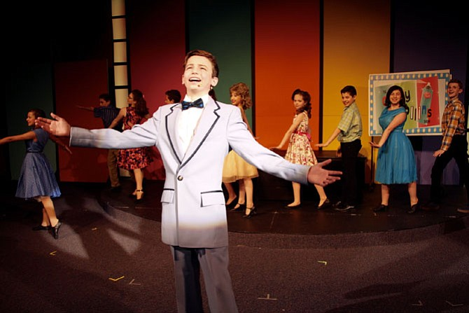 Corny Collins, played by Nathan Miller, and the Council Members singing 'The Nicest Kids in Town.'